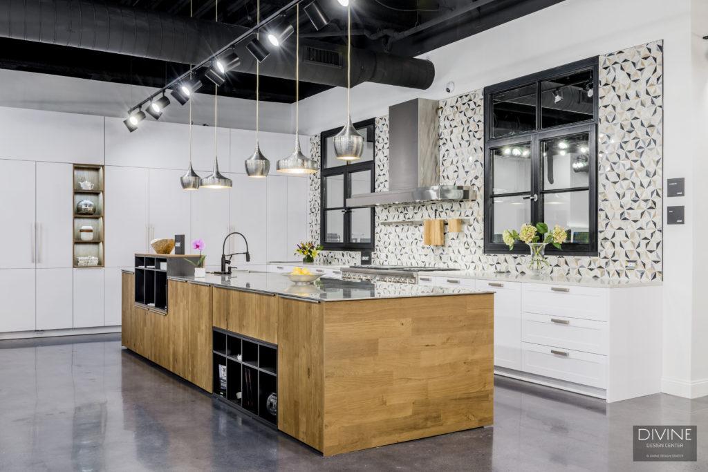 arteriors lighting, pendant lights, leicht kitchens, mosaic backsplash, stainless hood, wood kitchen island, brushed metal, white cabinetry, modern lighting